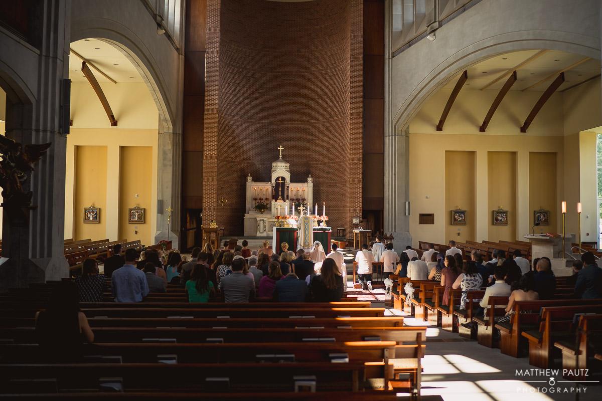 sunbeams streaming into church windows during wedding ceremony