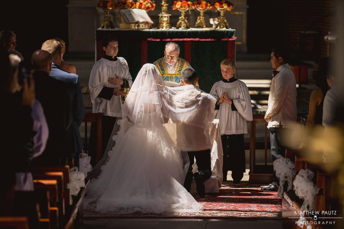 bride and groom at prince of peace catholic church wedding