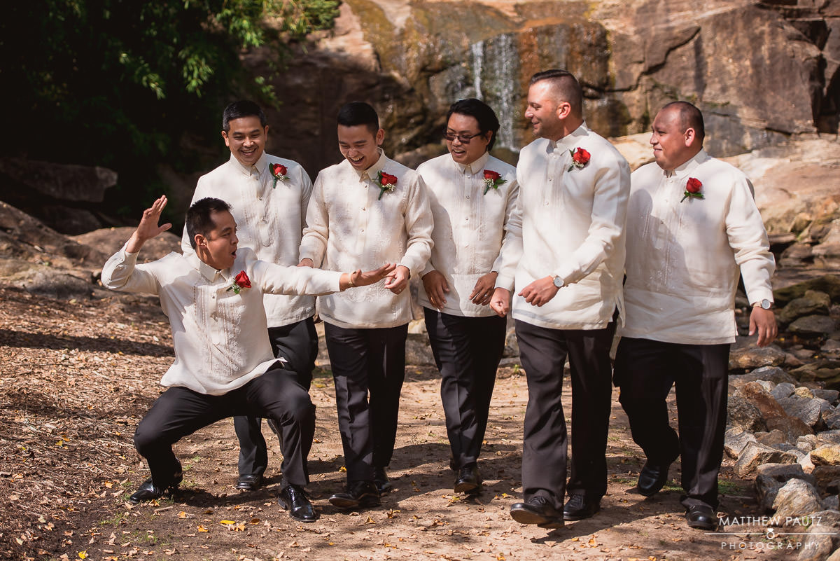 groomsmen goofing off during group photos