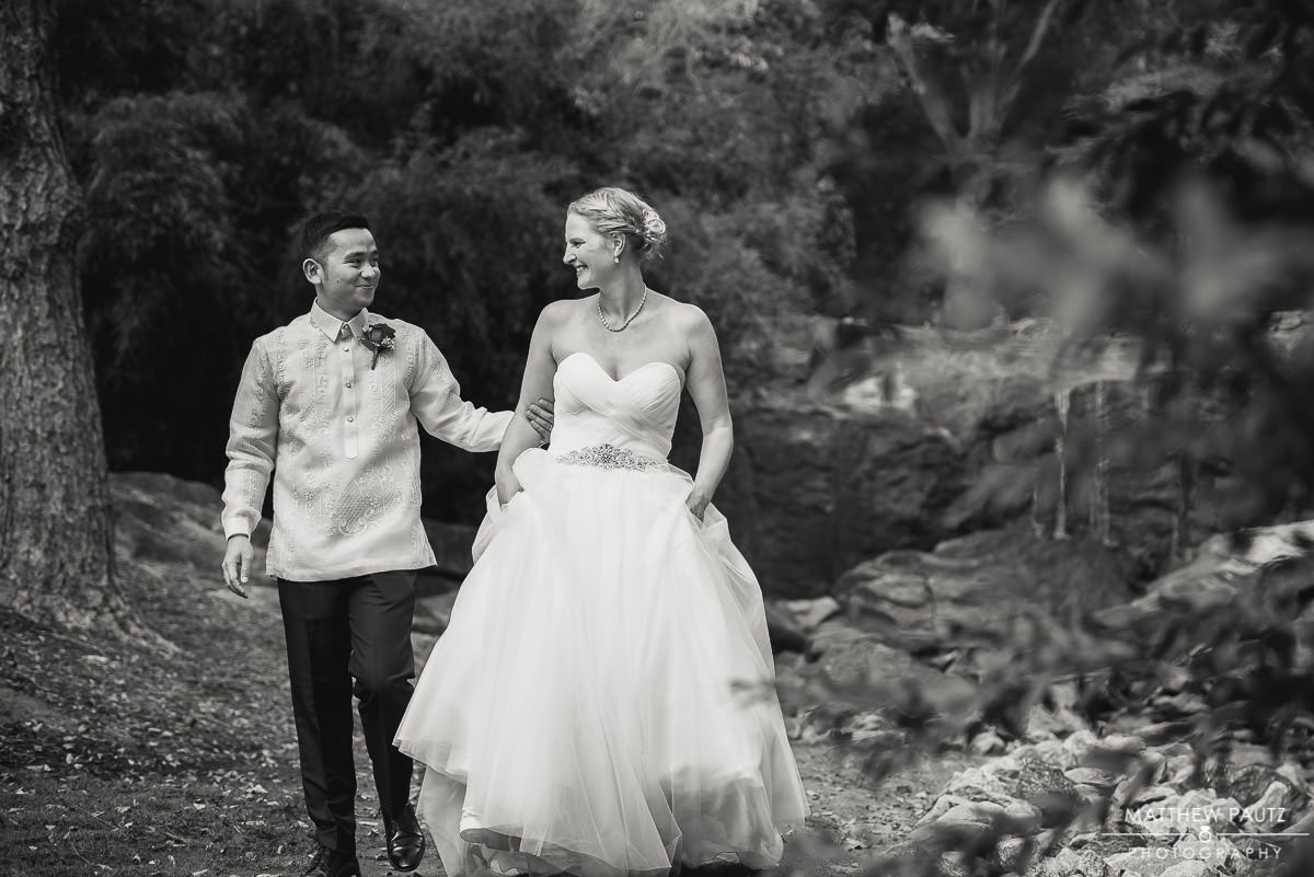 bride and groom walking together hand-in-hand