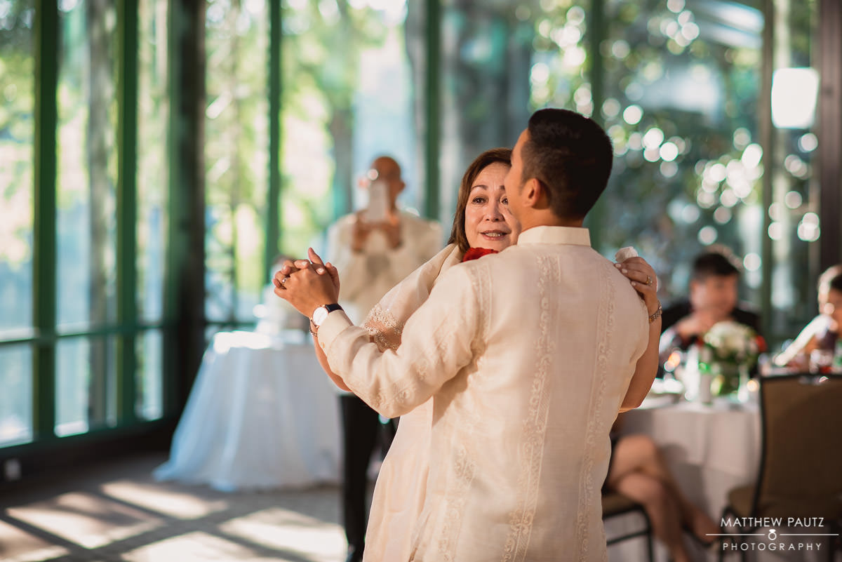 groom and his mother dancing together