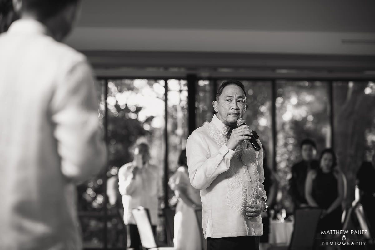 father of the groom giving wedding reception toasts