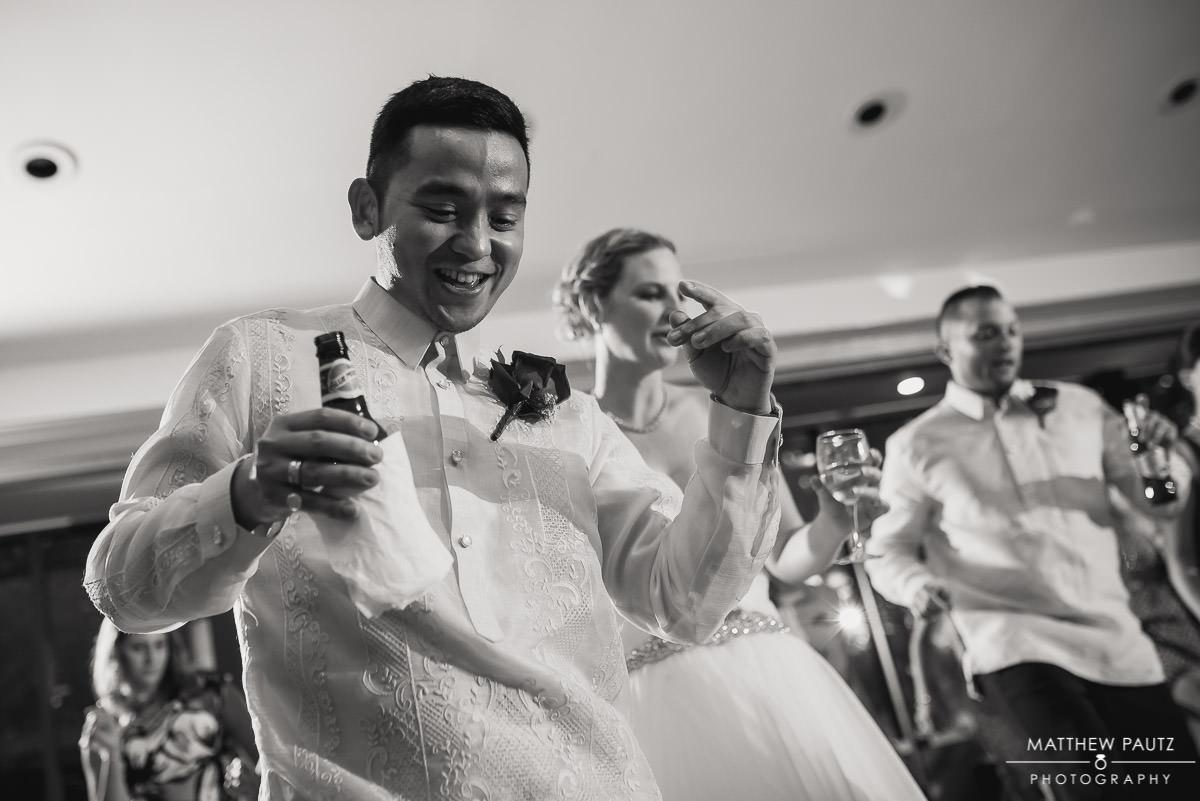 Bride and groom dancing hard at wedding reception