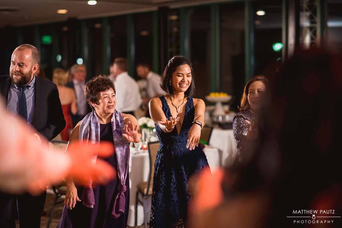 wedding guests dancing to the Macarena
