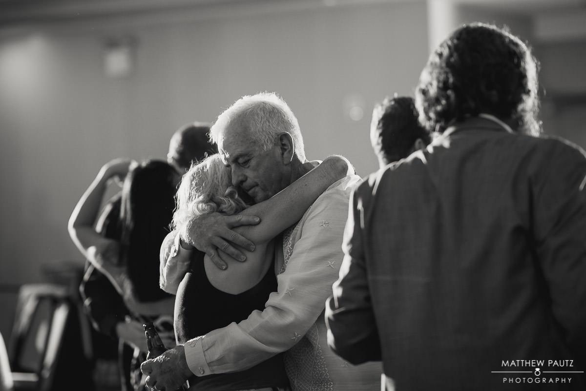 bride's parents dancing together at reception
