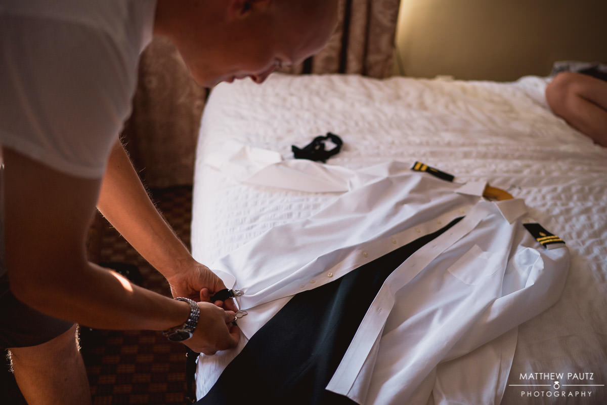 Groom getting ready before military wedding