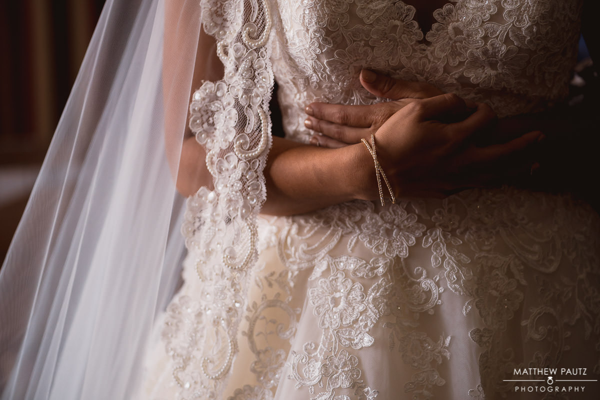 closeup details of bride wearing dress
