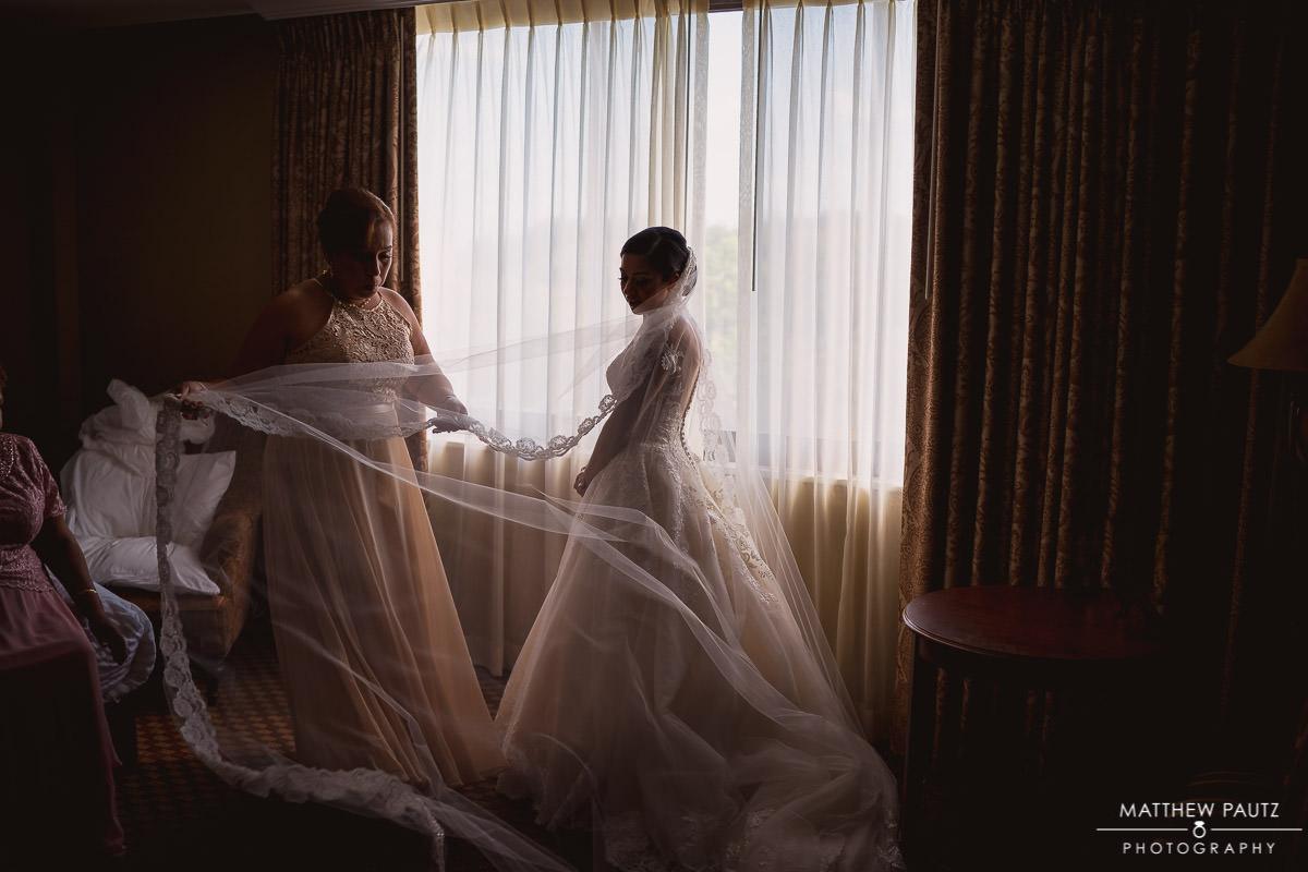 bride getting dressed in hotel