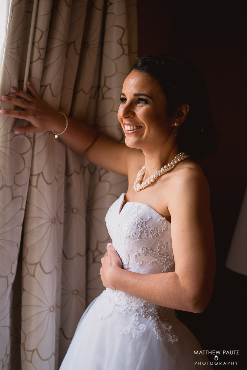 bride laughing while looking out window