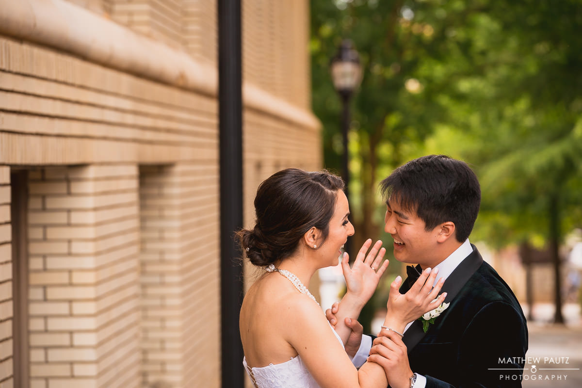 bride and groom laughing and holding hands