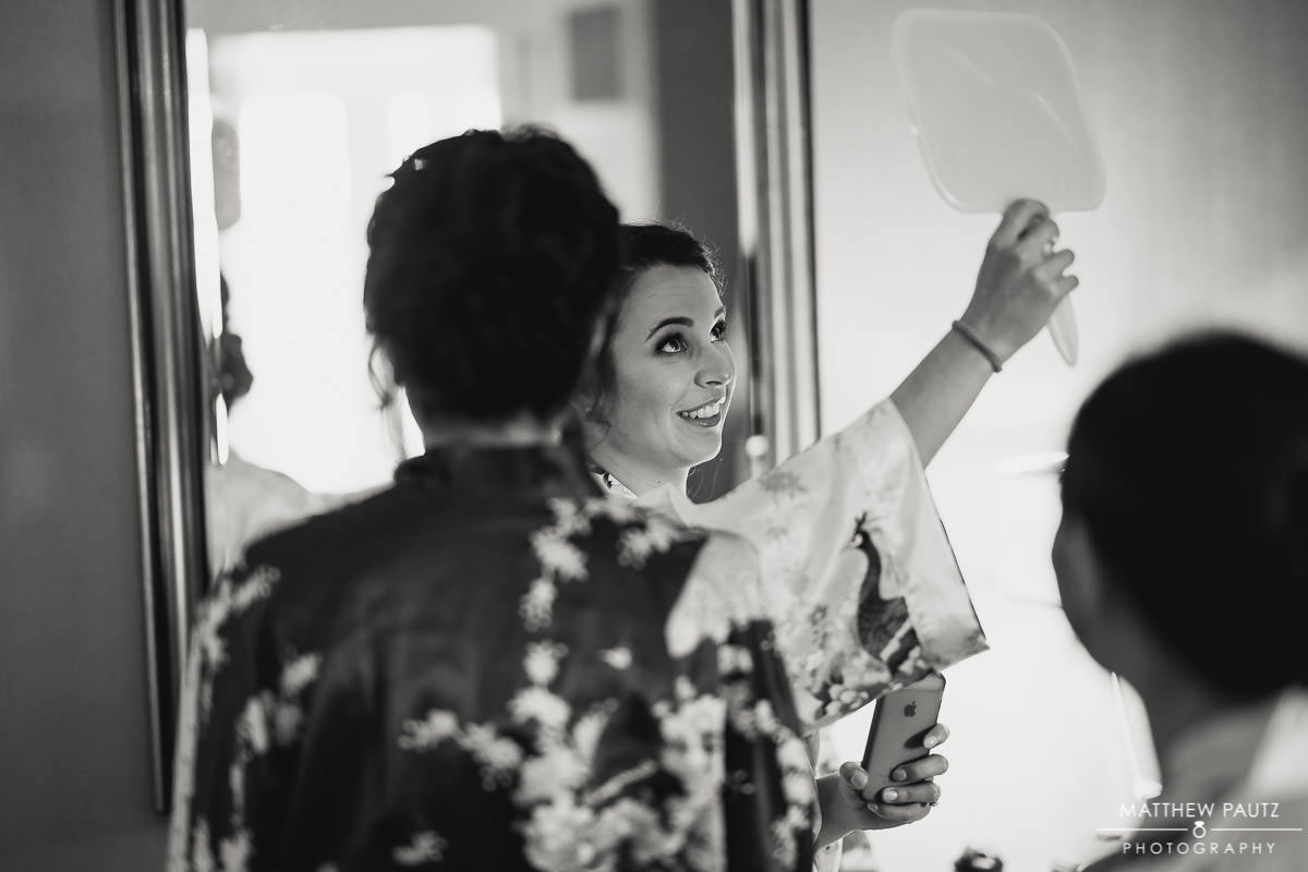 bride checking hair out in mirror