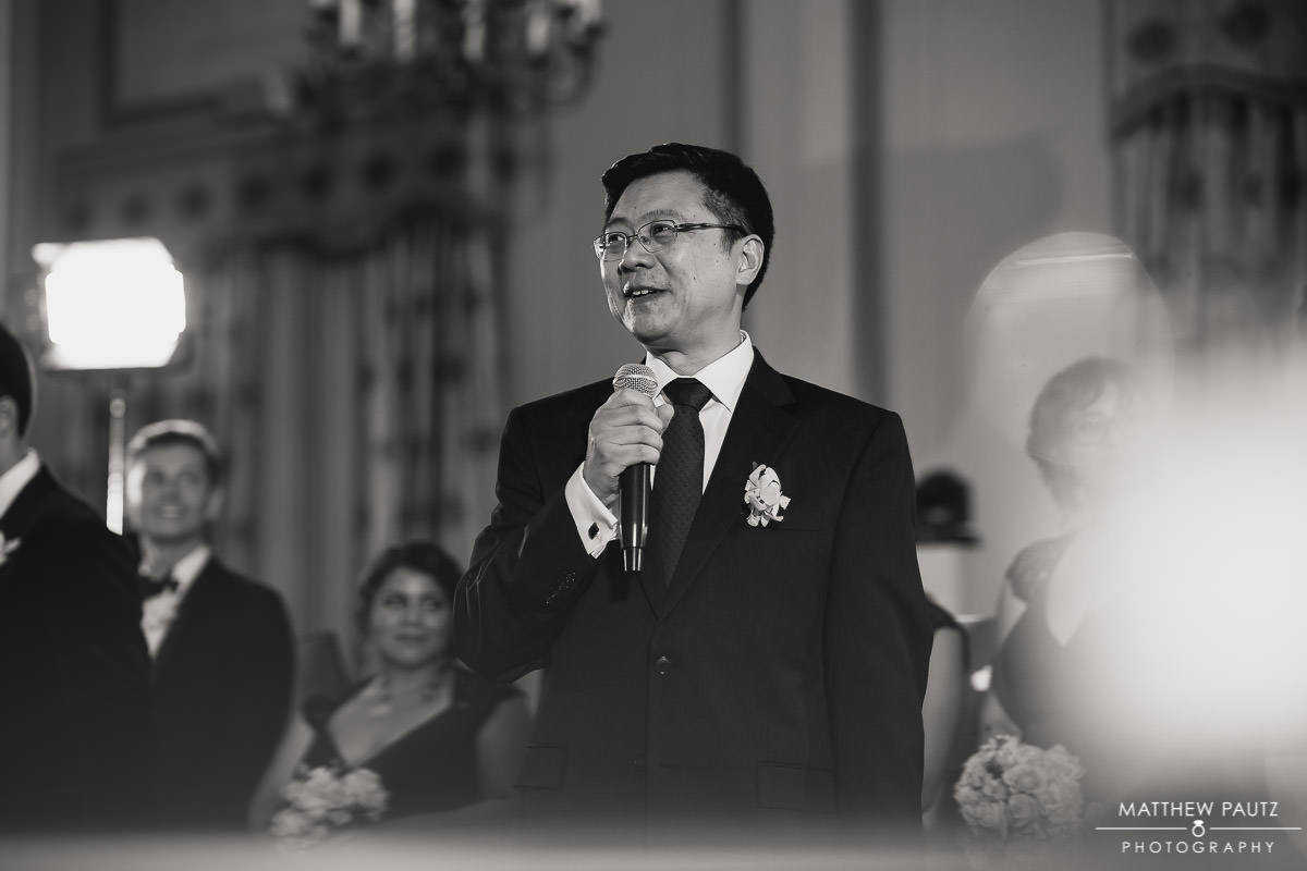 father of the groom giving toast at wedding reception