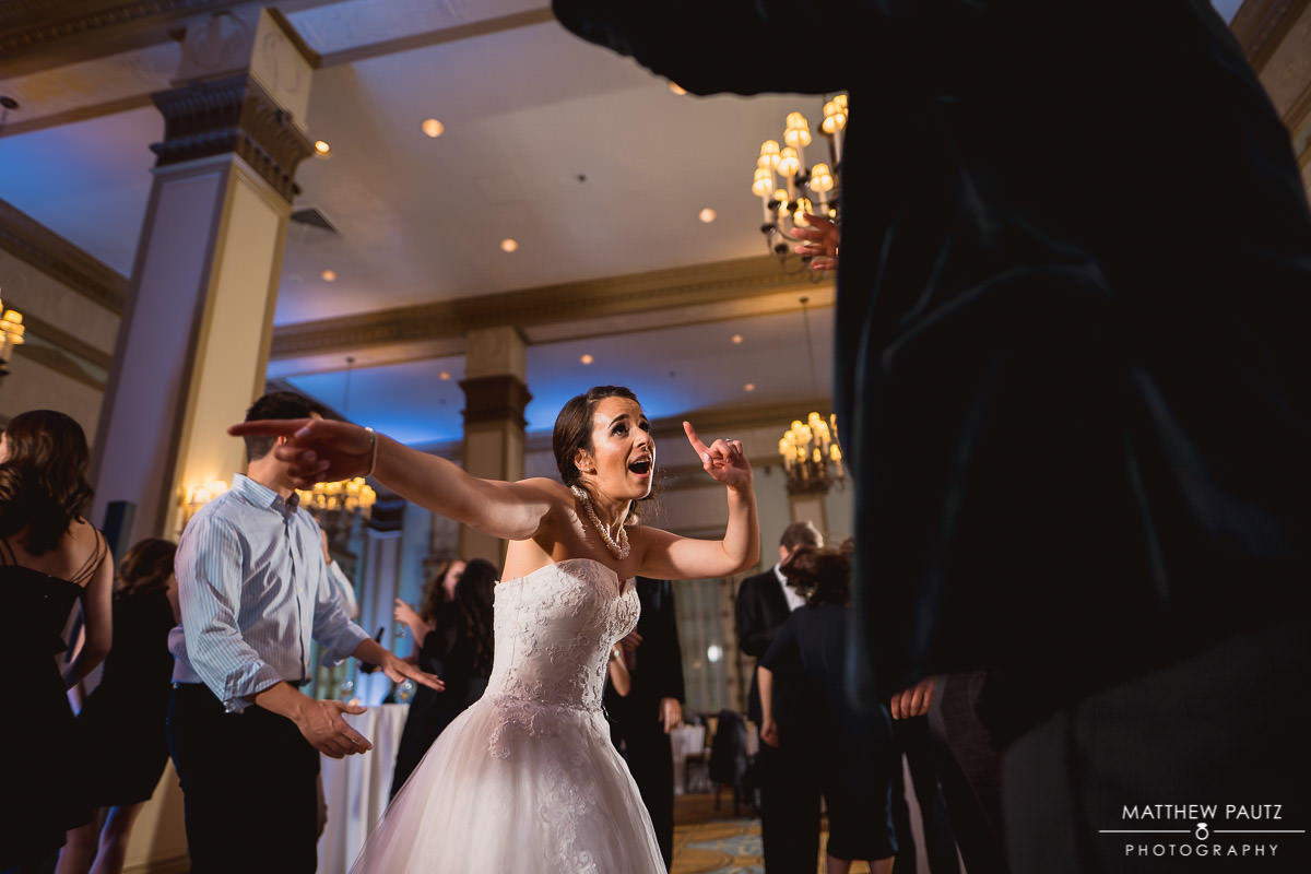 bride dancing with groom at reception