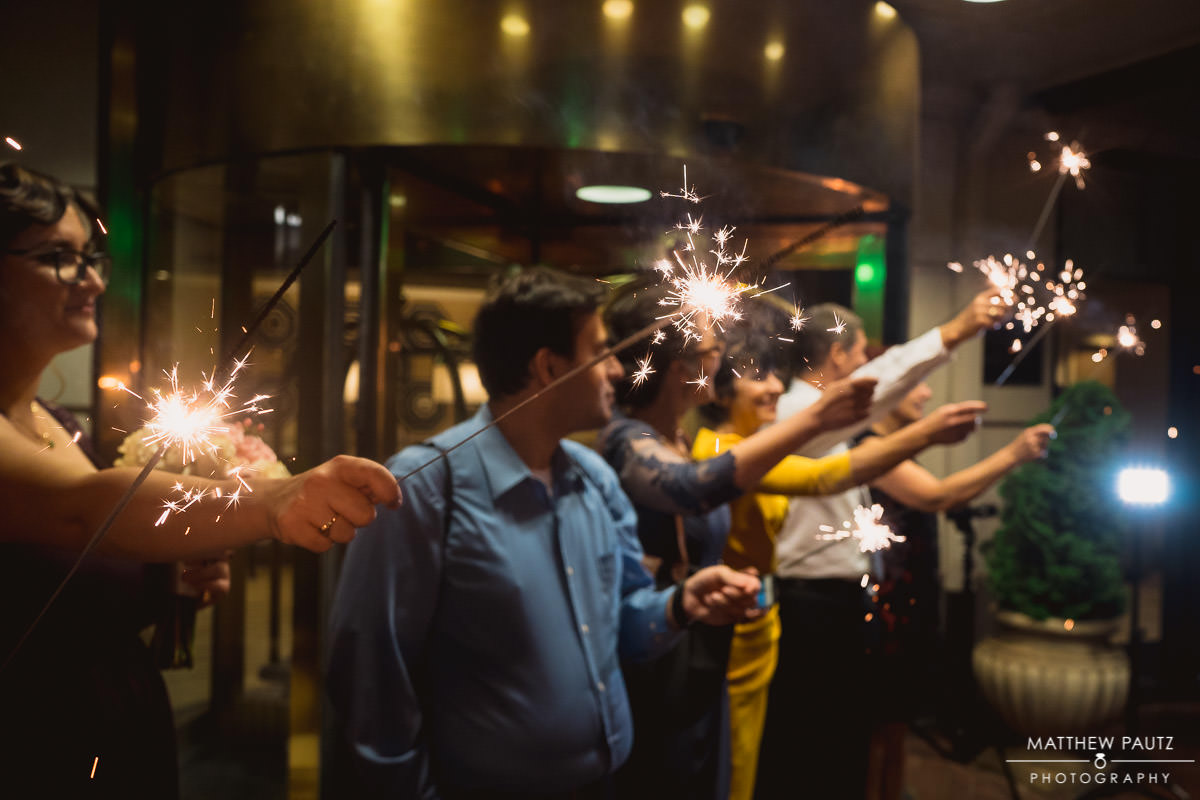 wedding guests lighting sparklers