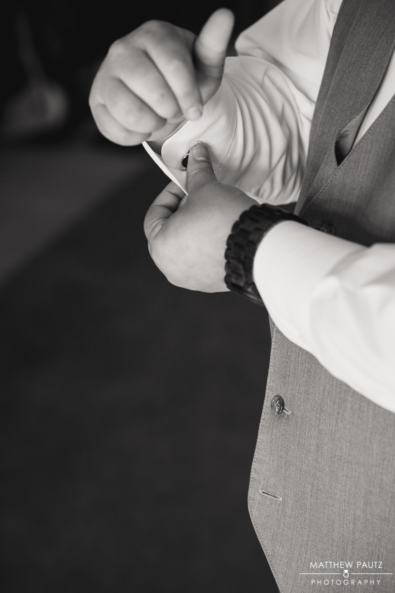 groomsman adjusting cufflinks