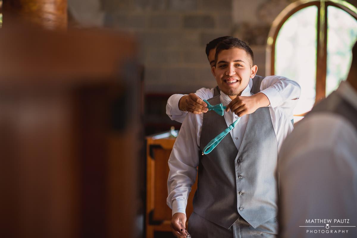 groomsmen getting dressed before wedding