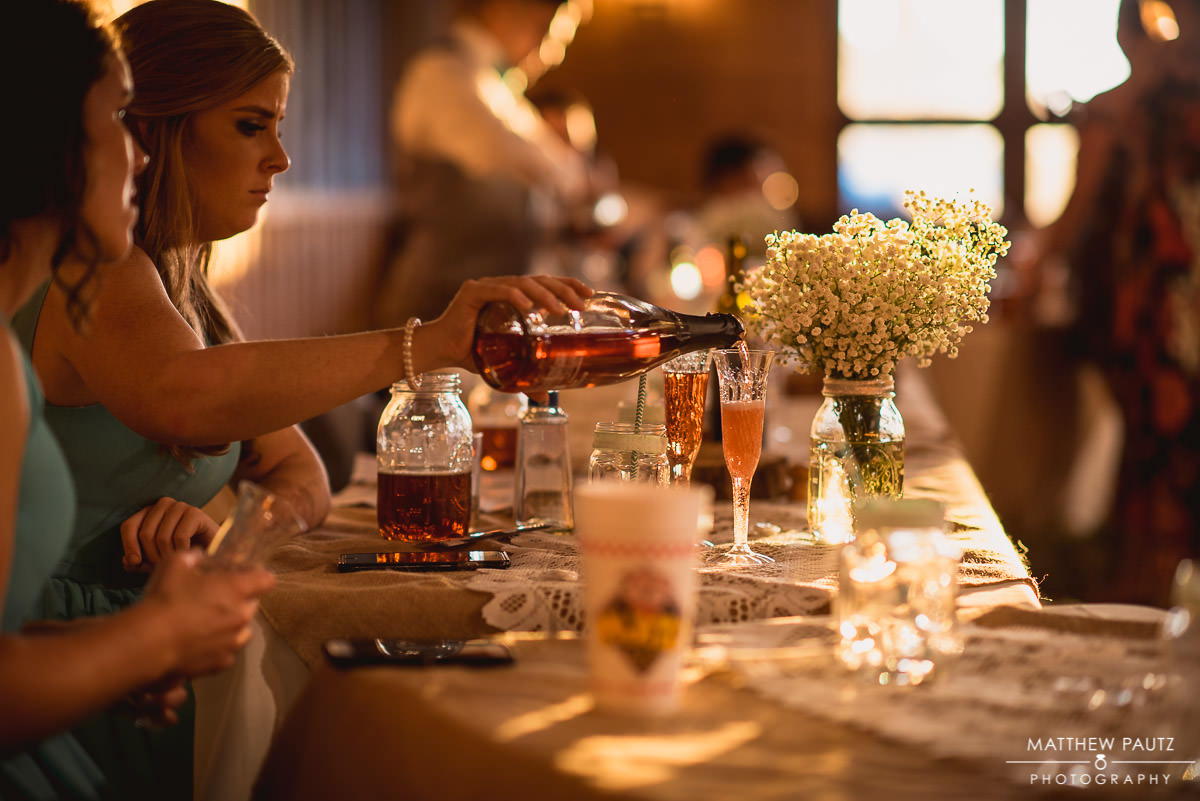 bridesmaids pouring champagne during reception