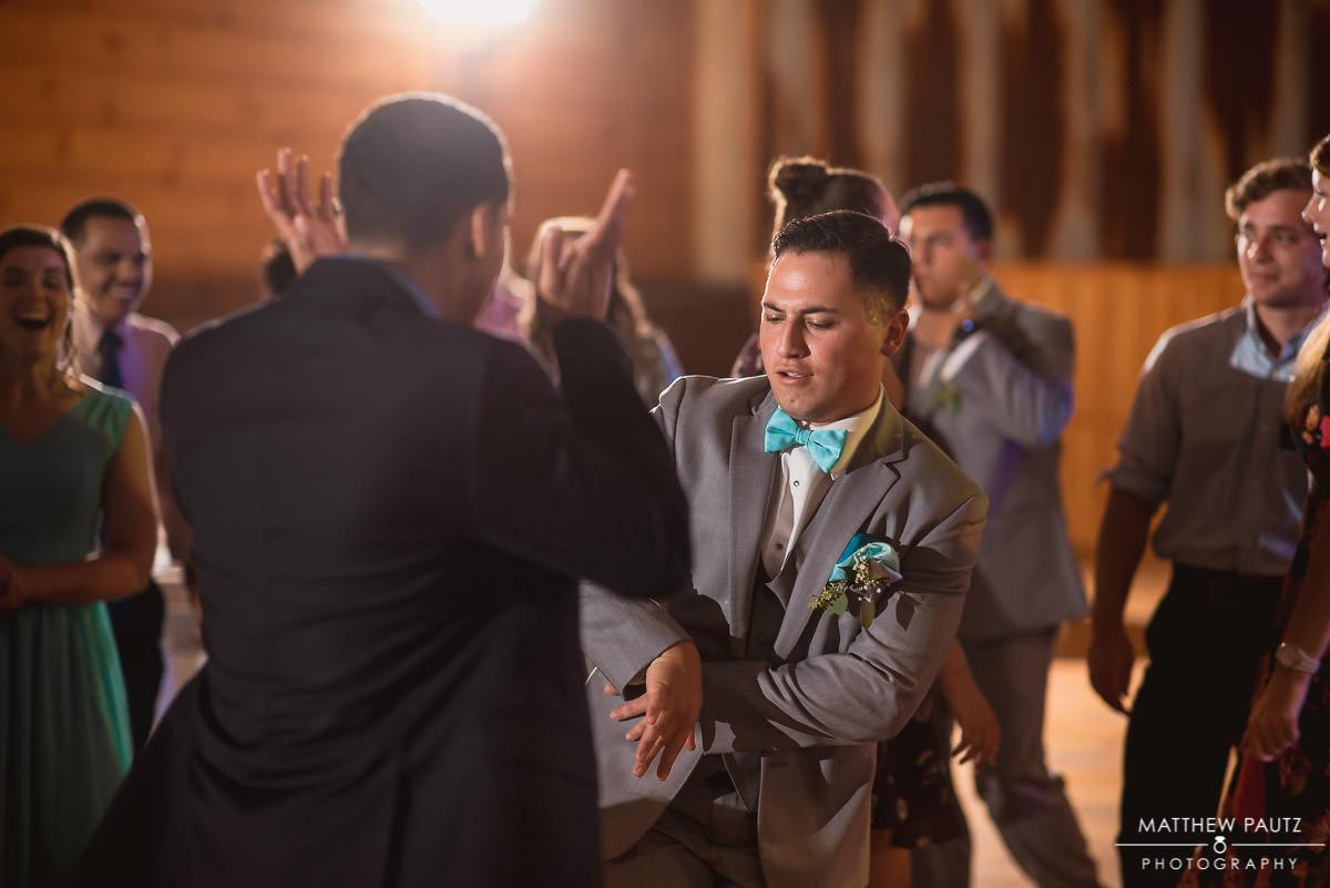 groomsman having a lot of fun dancing at reception