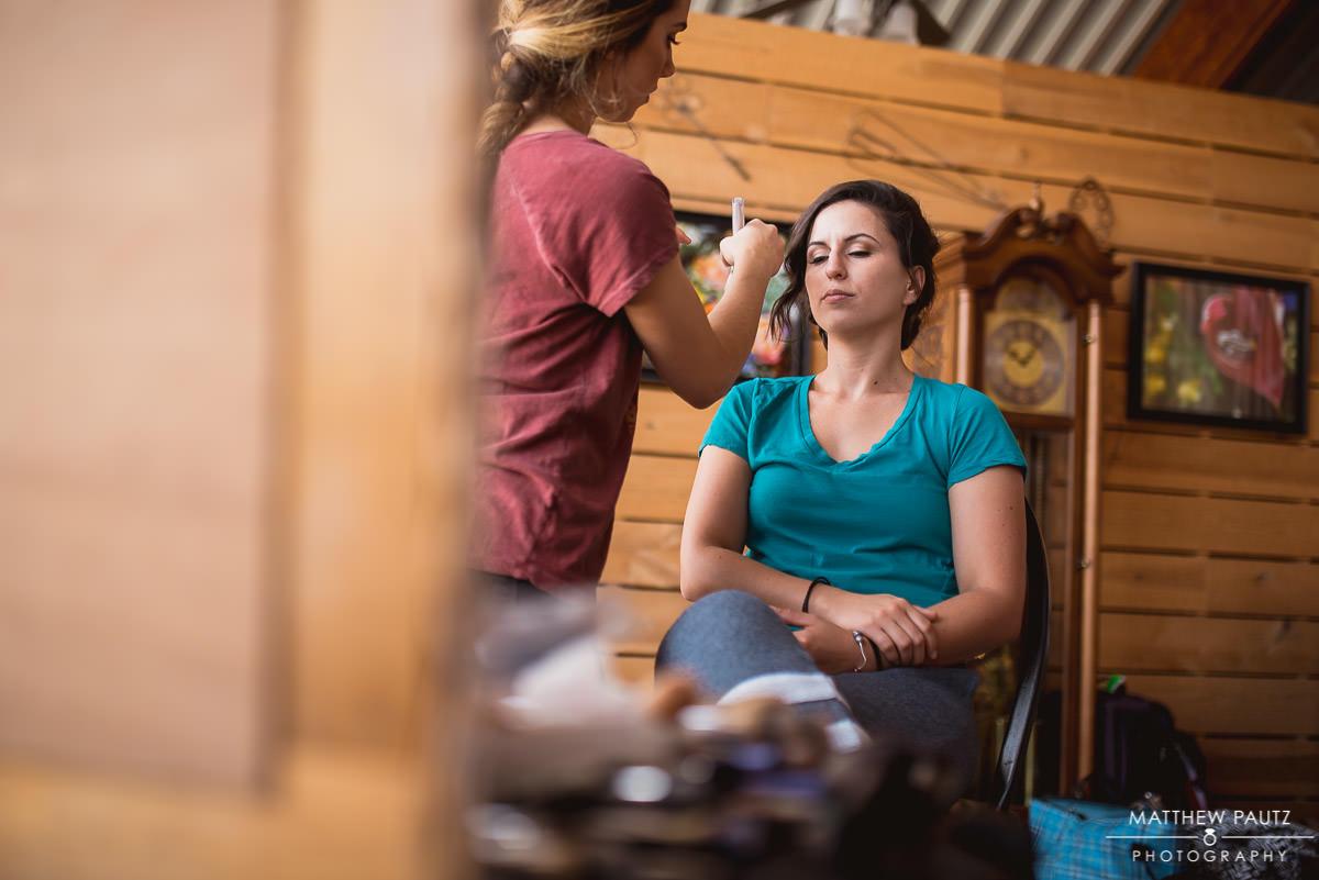 bridesmaid doing makeup before wedding