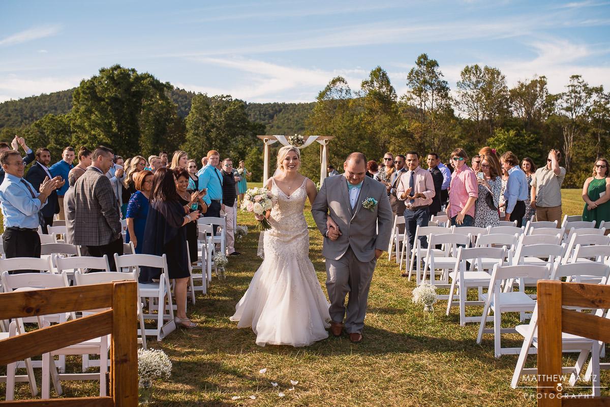 newlyweds walking away from wedding ceremony