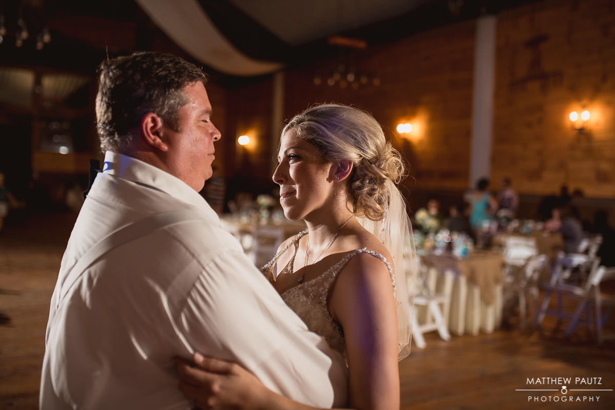 bride dancing with her father after wedding