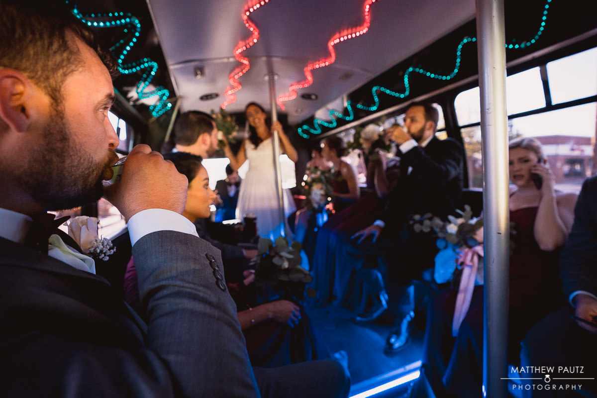wedding party in party bus after ceremony
