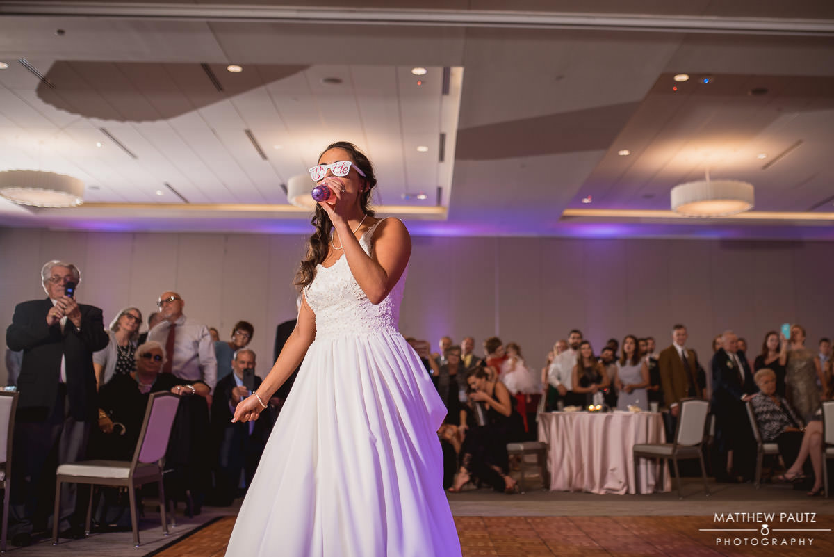 bride having a lip sync battle at wedding reception