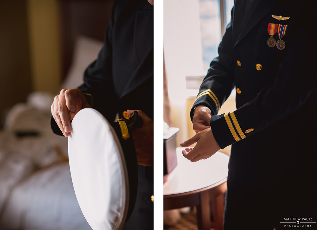 groom putting on military uniform before wedding