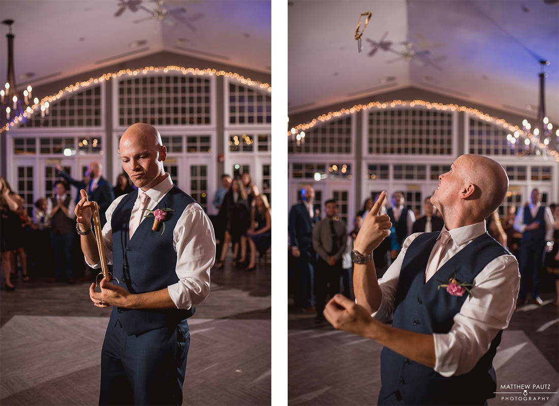 groom throwing garter at reception