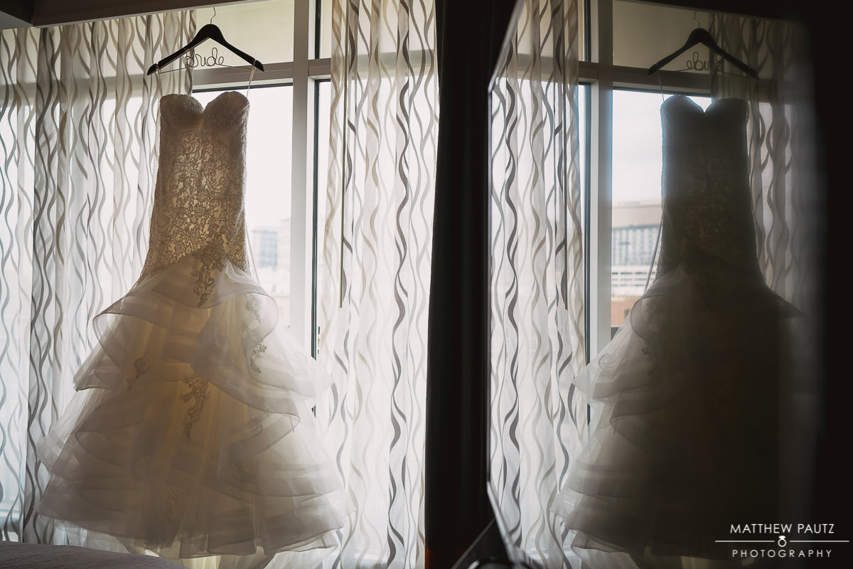 wedding dress hanging in window at The Embassy Suites
