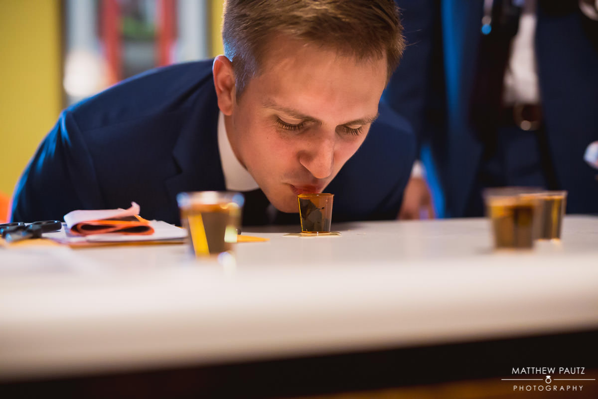 groom taking a shot before wedding