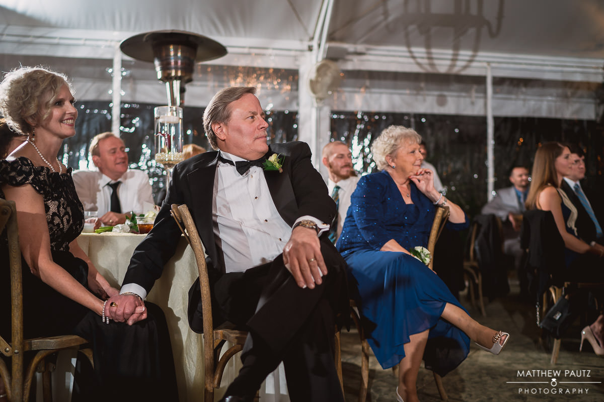 parents of the bride watching them dance at wedding reception