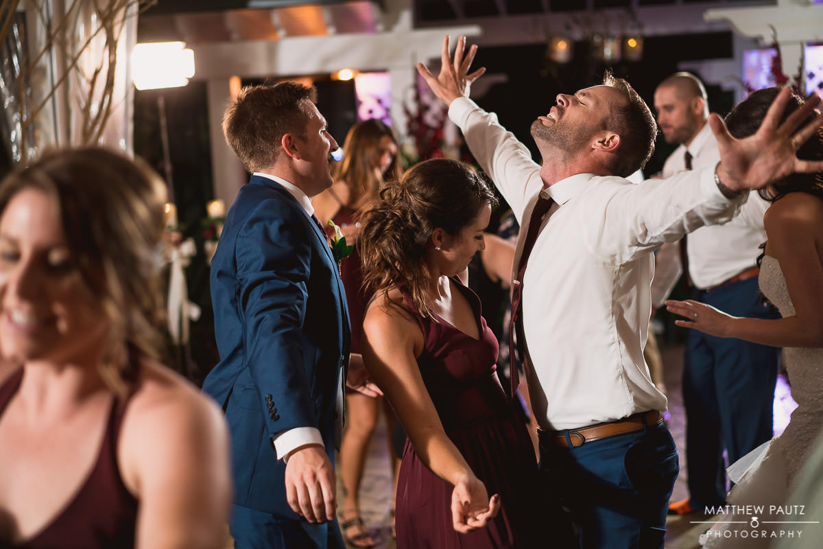 fun dancing photos at wedding reception