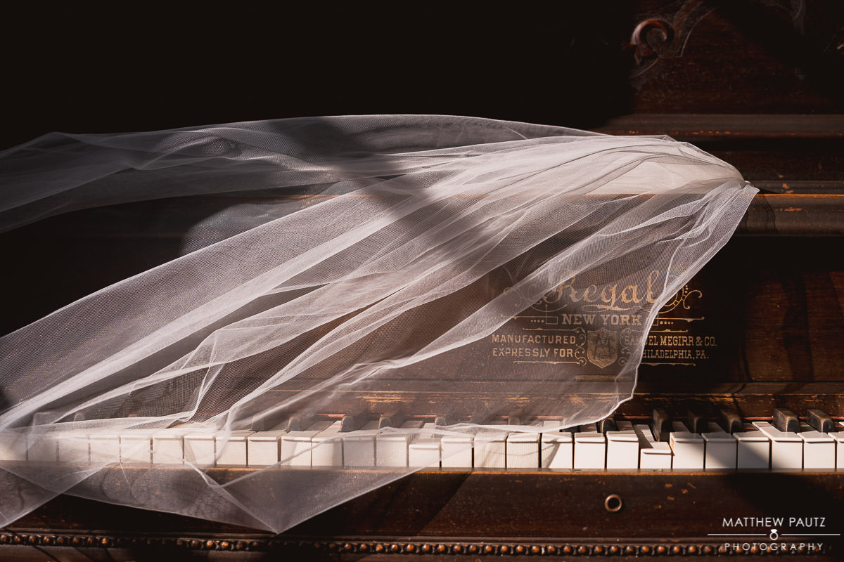 bridal veil laying over piano keys