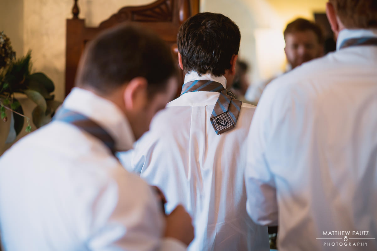 Groomsmen getting dressed on wedding day