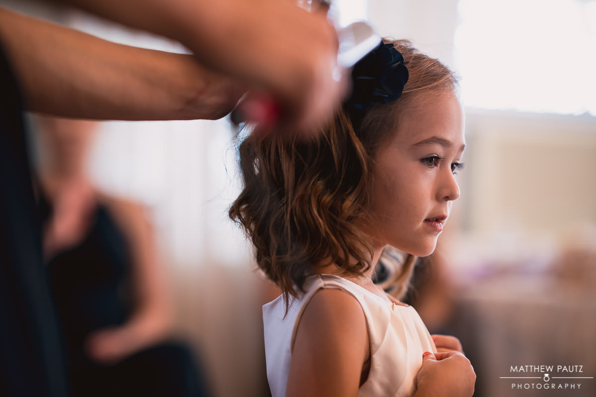 Flower girl getting hair styled