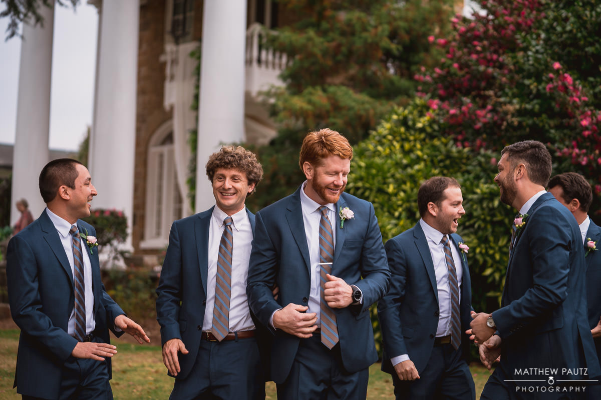 groomsmen goofing off before wedding ceremony at the Gassaway Mansion