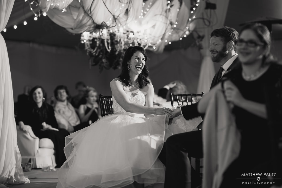 bride laughing at reception toasts