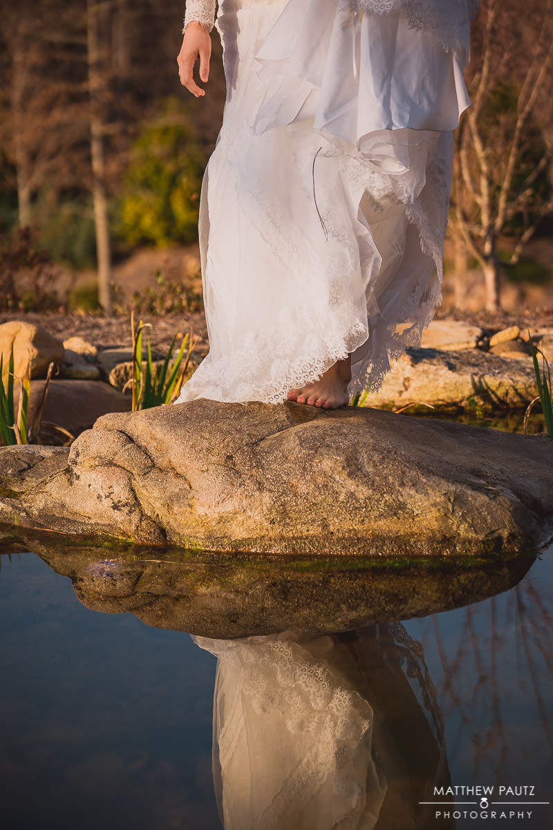 closeup of Bride standing on rock in pond