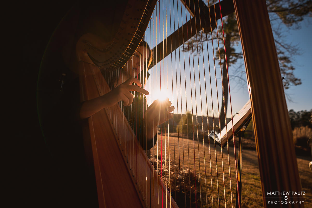 Wedding harpist playing at sunset