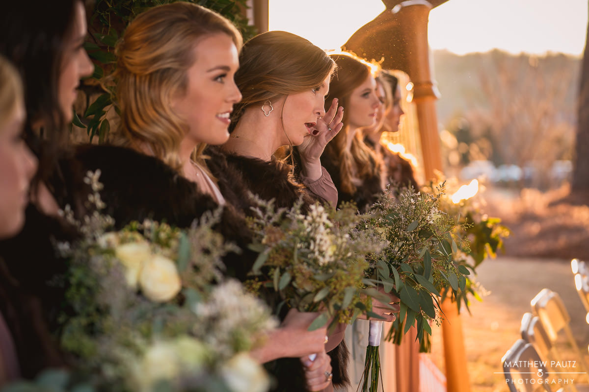 bridesmaids watching and reacting to bride at ceremony