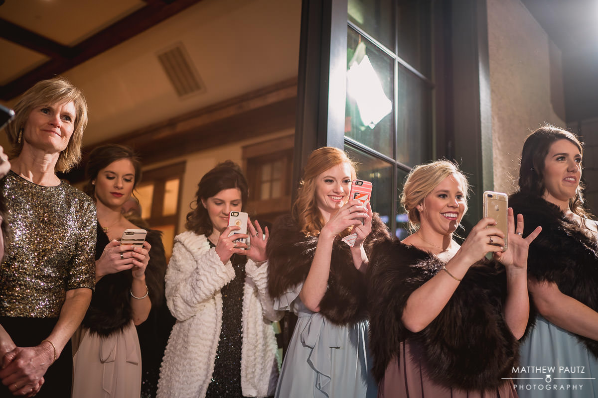 bridesmaids watching the first dances at wedding reception