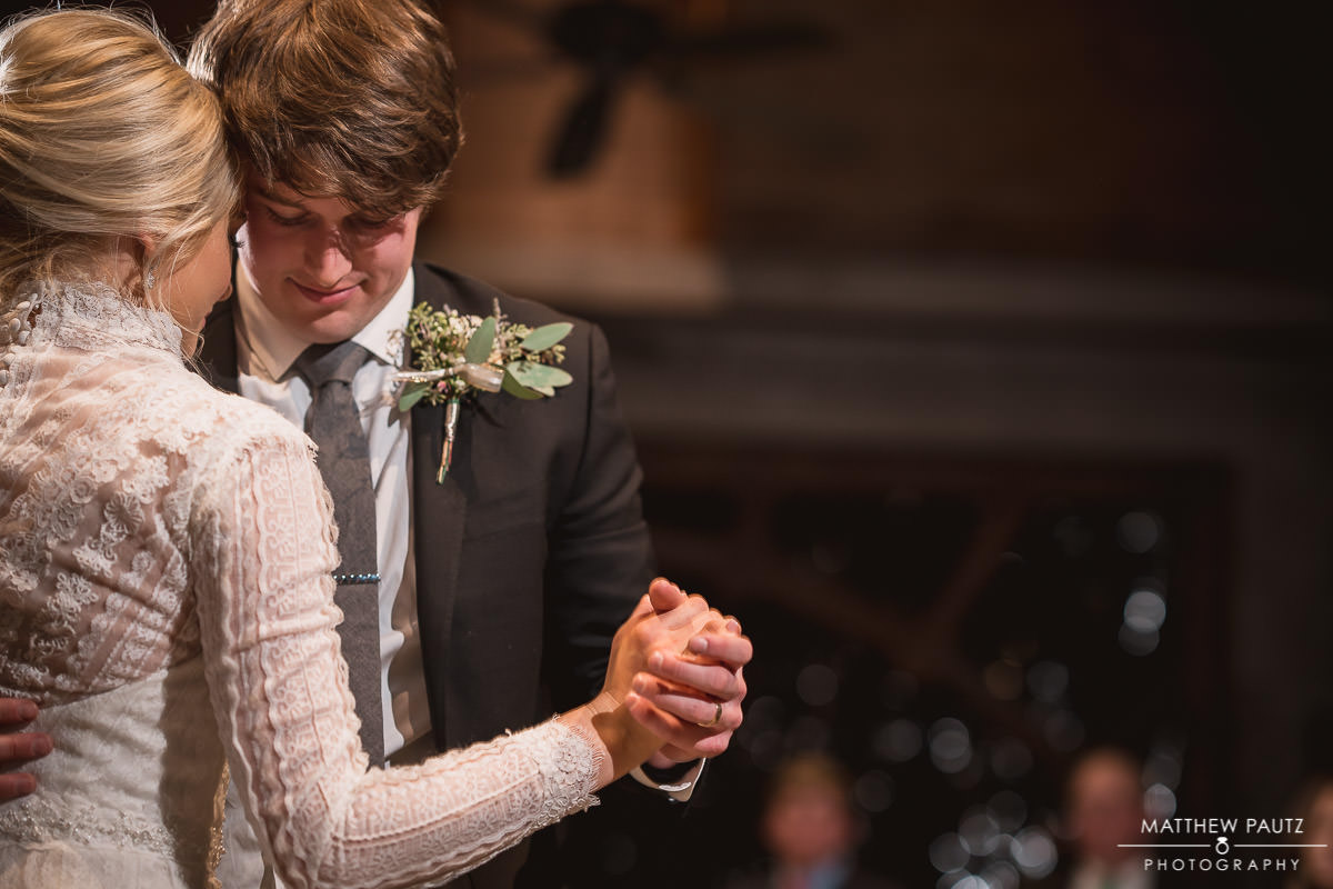 bride and groom dancing together at wedding reception