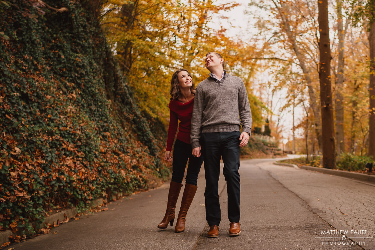 Goofy couple walking together in Falls Park