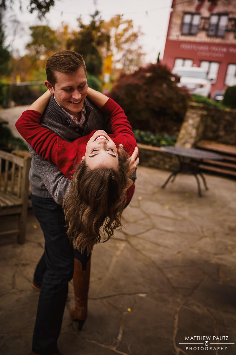 engaged couple dancing together in Falls Park