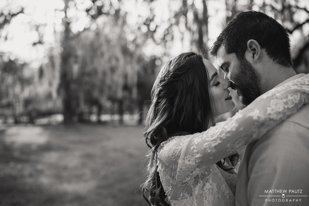 engaged couple hugging in Charleston Sc