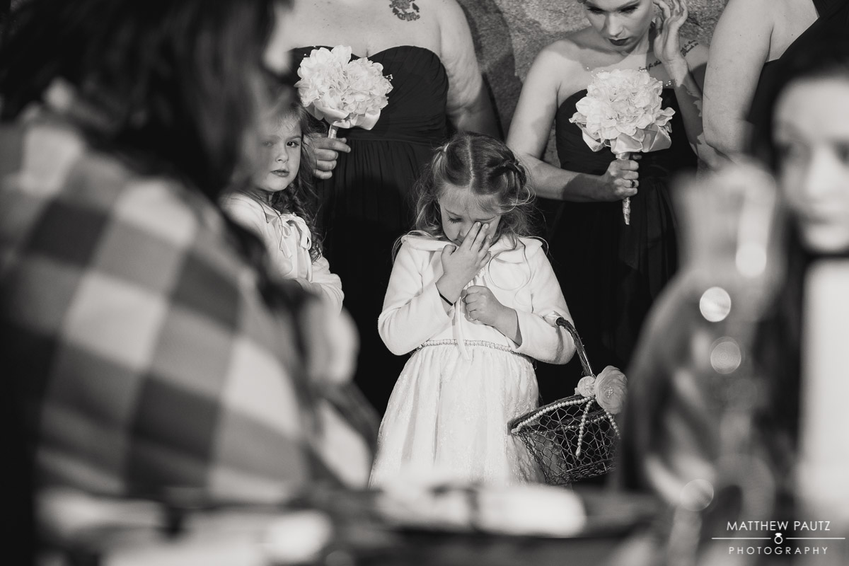 Flower girl crying during wedding ceremony