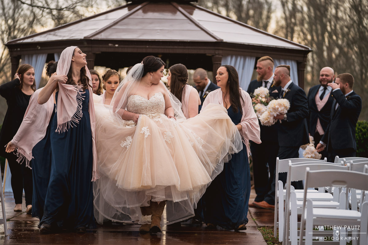 bride walking with her bridesmaids during rainy wedding