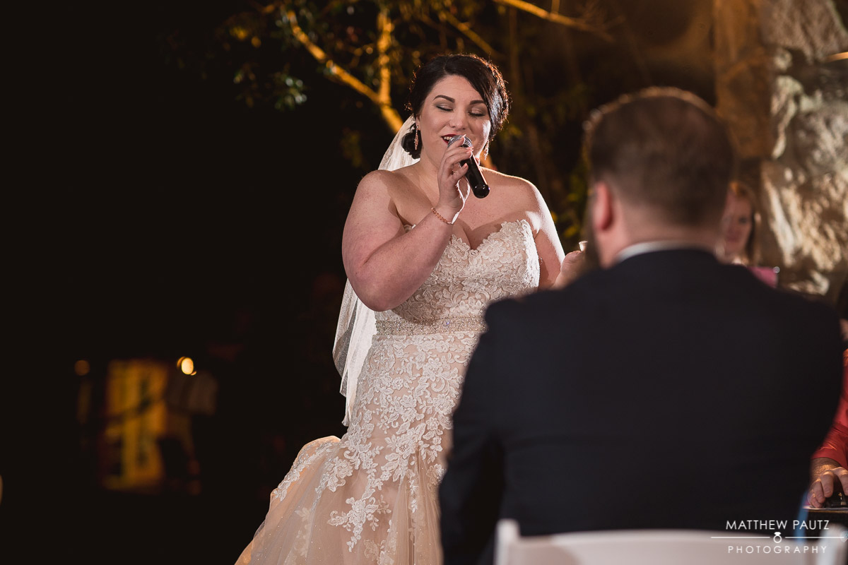 Bride singing to groom during wedding reception at Hopkins Farm