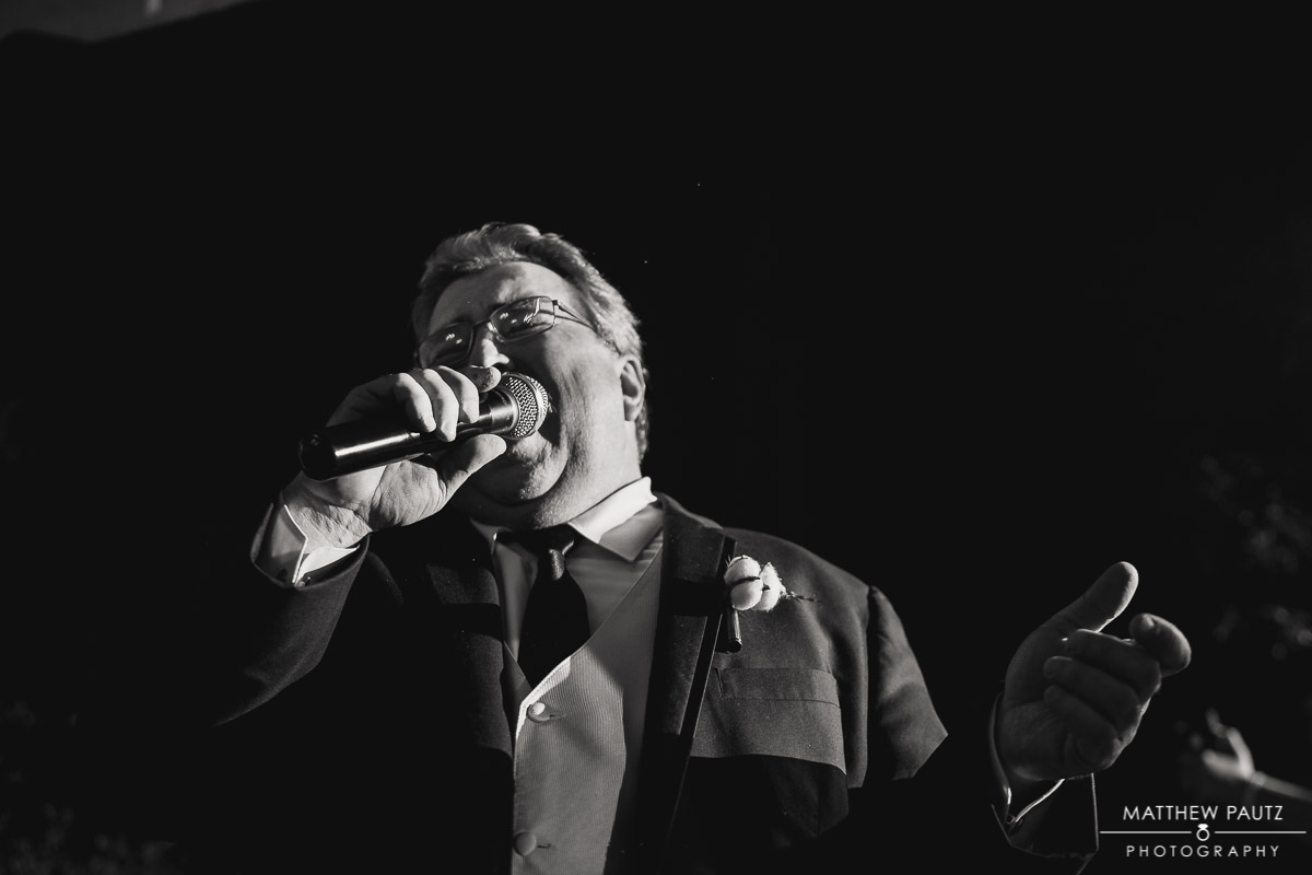 Father of the bride singing at wedding